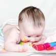 Nice baby draws finger-type paints — Stock Photo
