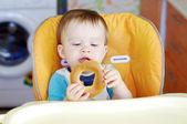Baby boy with round cracknel — Stock Photo