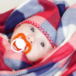 Lovely four-months baby with pacifier — Stock Photo