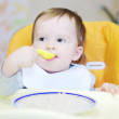 Lovely baby eats cereal — Stockfoto