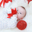 Baby with gift in hands — Stock Photo