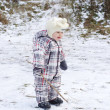 Baby age of 1 year walks on first snow — Stock Photo