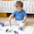 Baby age of 1 year paints with felt-pens — Stock Photo