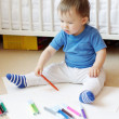 Baby paints at home — Stock Photo