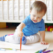 Baby age of 1 year paints at home — Stock Photo
