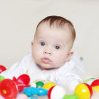 Baby age of 4 months among toys — Stock Photo