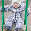 Baby on seesaw outdoors — Stock Photo