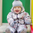 Happy baby on slide — Stock Photo