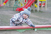 Baby playing with sand on playground — Stock Photo