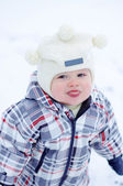 Baby putting out his tongue in winter — Stock Photo