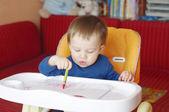 Baby paints — Stock Photo