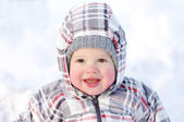Smiling baby with rosy cheeks in winter — Stock Photo