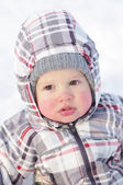 1 year baby with rosy cheeks in winter outdoors — Stock Photo