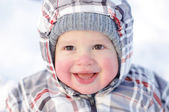 Happy 1 year baby with rosy cheeks in winter — Stock Photo