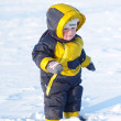 1 year baby walking in winter outdoors — Stock Photo
