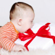 Baby age of 5 months with gift — Stock Photo