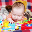 5 months baby with toys — Stock Photo