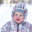 Stock Photo: Smiling baby with rosy cheeks in wintertime