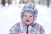 Smiling baby with rosy cheeks in wintertime — Stock Photo
