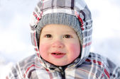 Happy baby with rosy cheeks in winter — Stock Photo