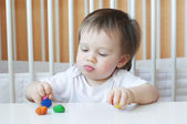 Little boy age of 1 year with plasticine — Stock Photo