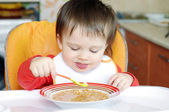 Baby eating soup — Stock Photo
