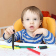 Stock Photo: Baby boy with pens at home