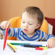 Stock Photo: Lovely baby age of 1 year painting