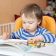 Stock Photo: Baby boy reading book