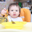 Stock Photo: Lovely baby with spoon