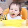 Stock Photo: Lovely baby eating soup
