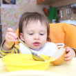 Stock Photo: 16 months baby eating soup and bread
