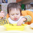 Stock Photo: Baby learns to eat soup