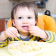 Stock Photo: Little boy eating corn curls