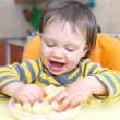 Stock Photo: Funny baby with corn curls