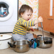 Stock Photo: Baby playing with pots