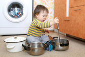 Baby playing with pots — Stock Photo
