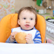 Stock Photo: Baby eating bread