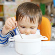 Stock Photo: Baby with empty plate