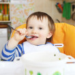 Stock Photo: Happy baby has dinner