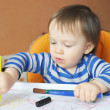 Stock Photo: Lovely baby paints with pens