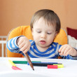 Stock Photo: Little boy age of 1 year paints with pens