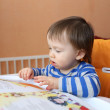 Stock Photo: Baby age of 16 months reading book