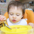 Stock Photo: Baby age of 16 months eating soup