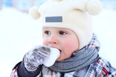 baby eating snow — Stock Photo