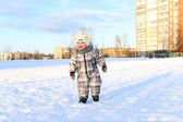 17 months baby walking outdoors in winter — Stock Photo