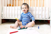 Lovely baby with pens — Stock Photo