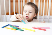 18 months baby paints — Stock Photo