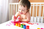 18 months baby with paints — Stock Photo