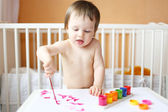Baby with paints — Stock Photo